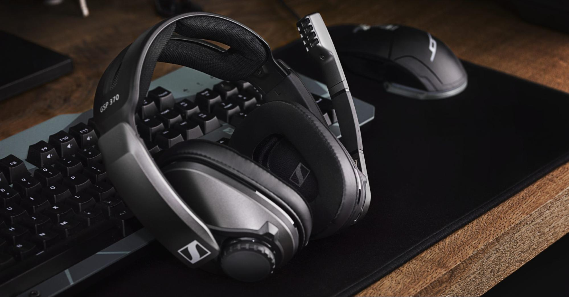 Sennheiser headphones with keyboard, mouse, and desk mat
